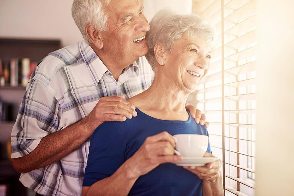 Elderly couple enjoying the morning view out of the window after Vitreo Retinal Microsurgery